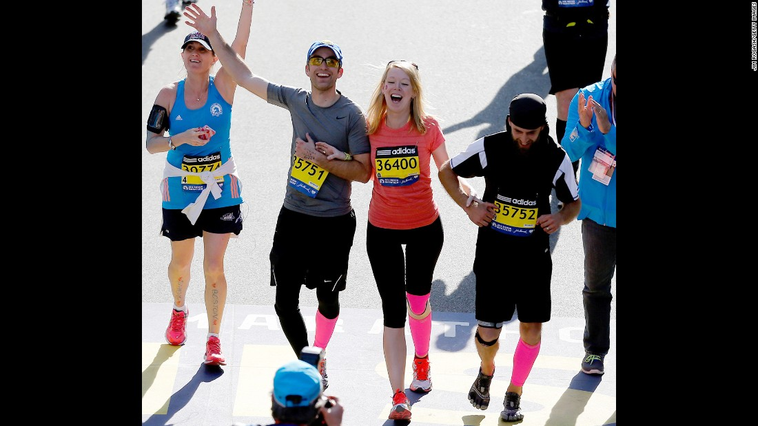 Marathon bombing survivor Adrianne Haslet-Davis crosses the finish line of the 118th Boston Marathon on April 21, 2014 in Boston, Massachusetts.