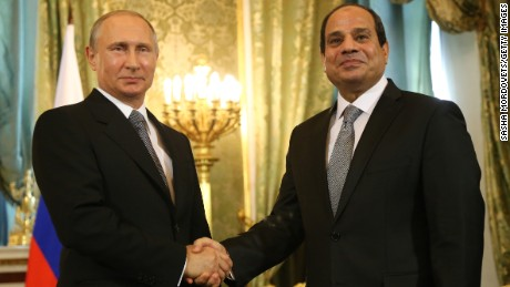 Russian President Vladimir Putin greets Egyptian President Abdel Fattah el-Sisi at the Kremlin on August 26.