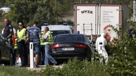 Forensic investigators work as police vehicles are parked behind a refrigerated truck parked along a highway near Neusiedl am See, Austria, on August 27, 2015. The bodies of between 20 and 50 migrants have been found in the truck on the A 4 highway in Austria, police said Thursday, the latest tragedy involving people desperately trying to reach Europe.. AFP PHOTO / DIETER NAGLDIETER NAGL/AFP/Getty Images