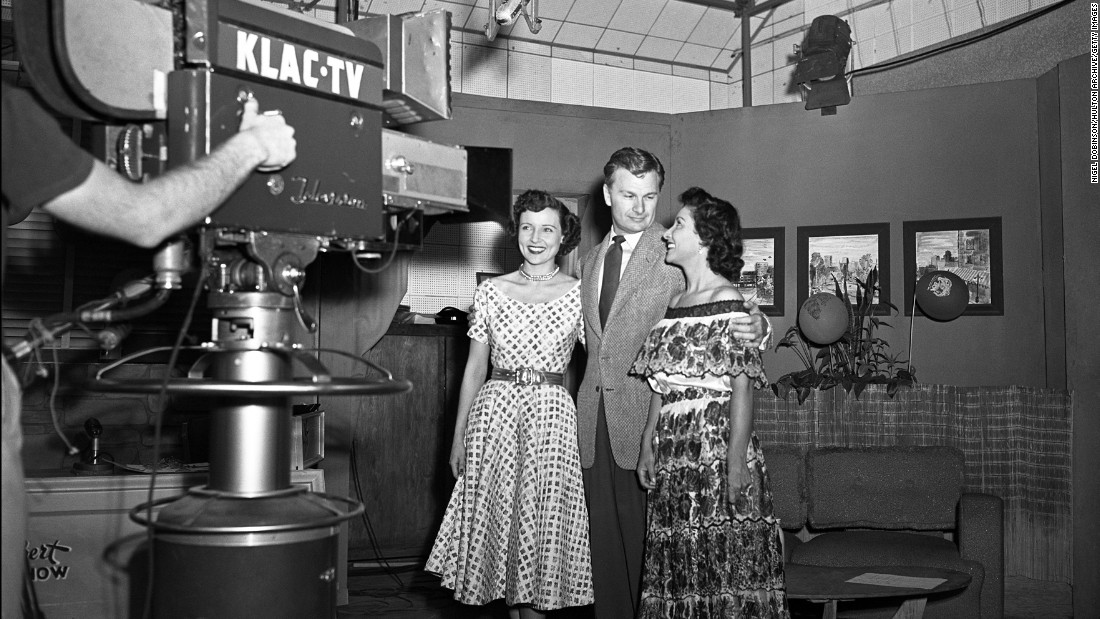 "Betty White, left, actor Eddie Albert, and an unidentified woman pose in front of the a KLAC-TV camera during a broadcast of the talk show, ""Hollywood on Television,"" in 1952. The show was ""like going to television college,"" she said."