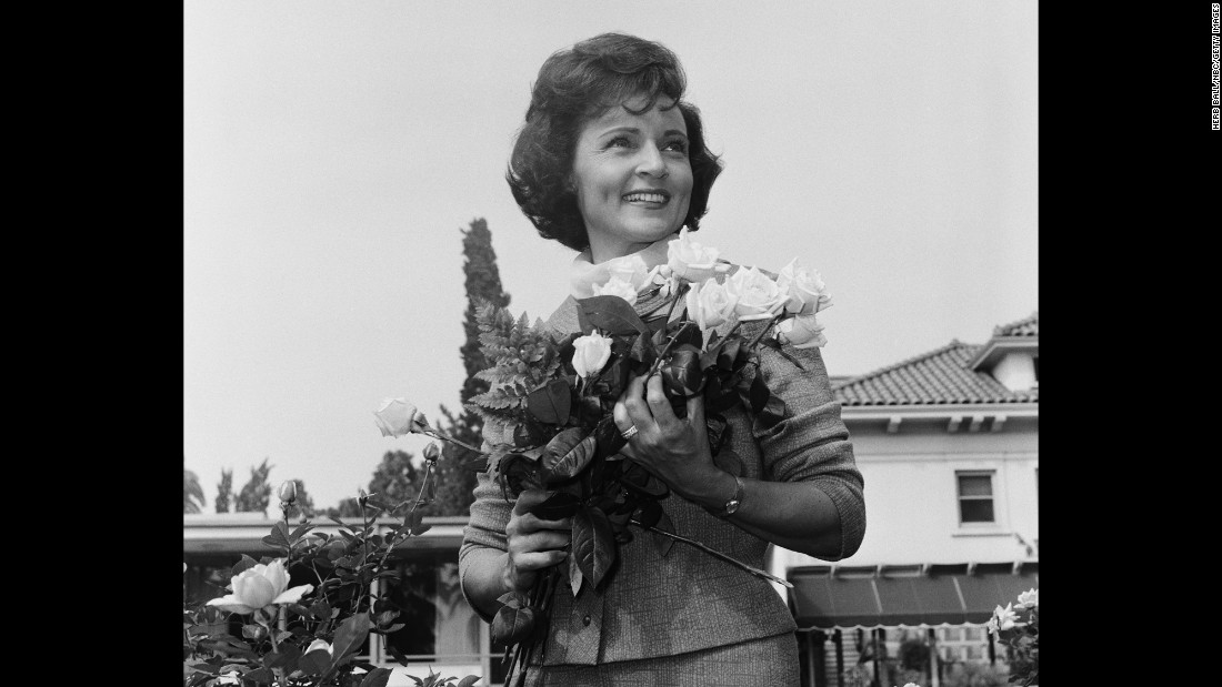 "White hosted countless parades, such as the 1964 Tournament of Roses in Pasadena, California. ""It got so that, if a signal would go red and six cars would line up, I'd announce them,"" she said."