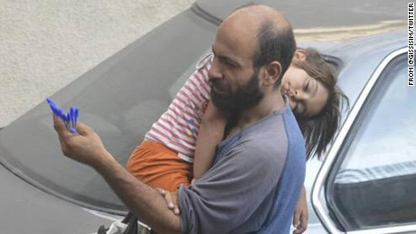 Gissur Simonarson's photo of Abdul selling pens on the streets of Beirut as he cradled his sleeping daughter struck a chord with more than 6,000 of  Simonarson's Twitter followers.