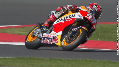 NORTHAMPTON, ENGLAND - AUGUST 28:   Marc Marquez of Spain and Repsol Honda Team rounds the bend during the MotoGp Of Great Britain - Free Practice at Silverstone Circuit on August 28, 2015 in Northampton, United Kingdom.  (Photo by Mirco Lazzari gp/Getty Images)