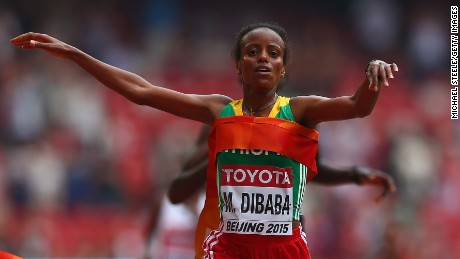 Mare Dibaba of Ethiopia takes gold in the women's marathon after a sprint finish in the Bird's Nest Stadium.