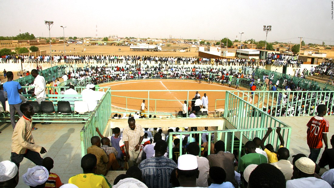 Arenas such as this one in Hajj Yousif, Khartoum, host the events. The ring is far larger than that used in Olympic wrestling and is covered with sand rather than softer, vinyl-covered mats.