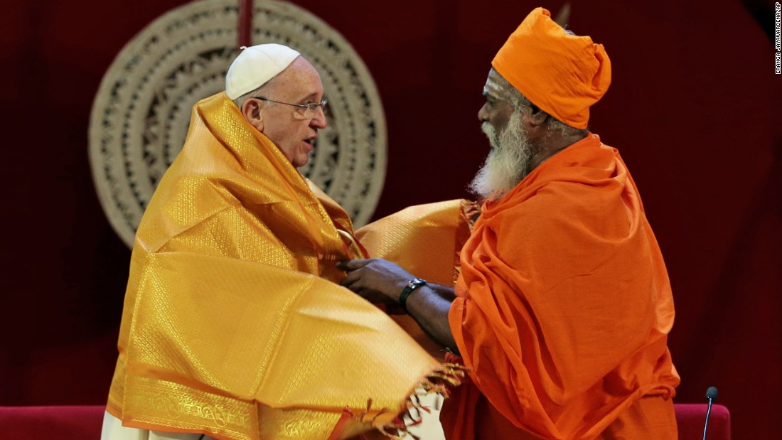 Hindu priest Kurukkal SivaSri T. Mahadeva presents a shawl to Pope Francis in Colombo, Sri Lanka, on Tuesday, January 13, 2015.