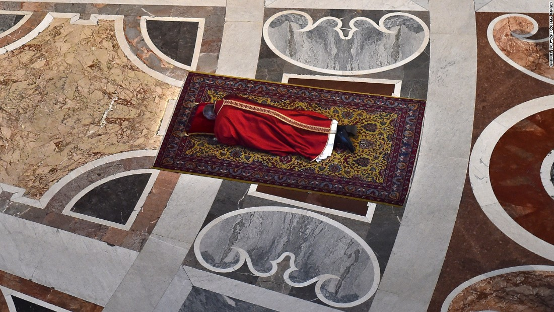 The Pope prays face down on the floor of St. Peter's Basilica during Good Friday celebrations at the Vatican on Friday, April 3, 2015.