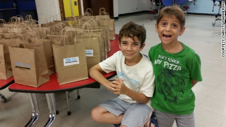 Braeden and his brother do prep work for 3B Brae's Brown Bags.
