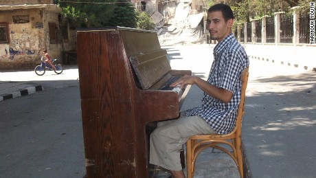 Ahmed plays piano in the middle of Damascus before it was destroyed by ISIS