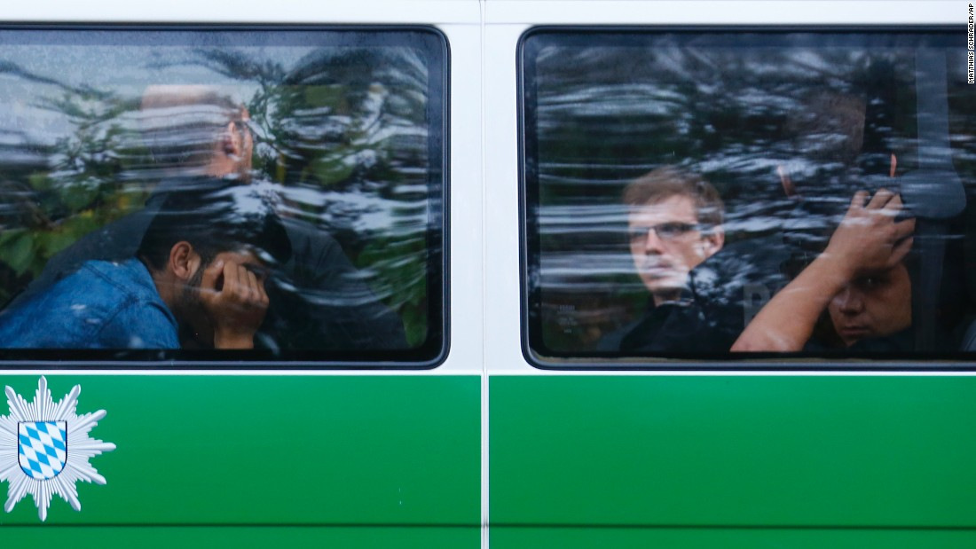 Migrants sit in a police bus in Pocking, Germany, after making their way to the country from Austria.