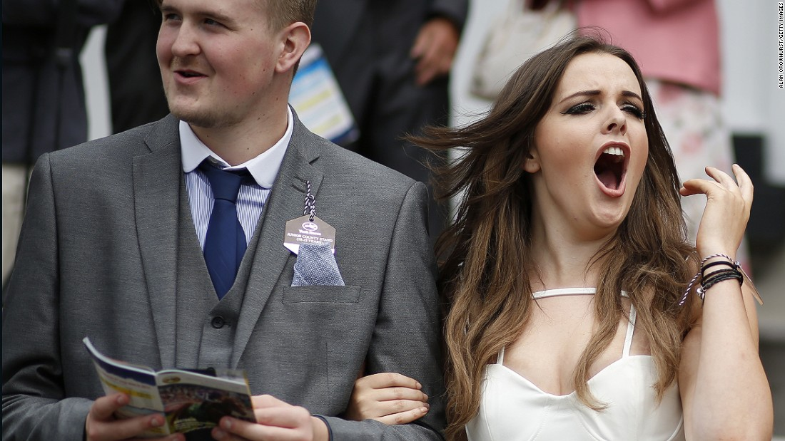 YORK, ENGLAND - AUGUST 21: A racegoer cheers her horse on at York racecourse on August 21, 2015 in York, England. (Photo by Alan Crowhurst/Getty Images)
