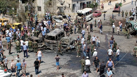 A handout image released by the official Syrian Arab News Agency (SANA) on September 2, 2015, shows security forces and people gathering at the site of a reported car bombing in the government-controlled coastal city of Latakia. At least seven people were killed and 40 wounded in a rare car bombing in the provincial capital of President Bashar al-Assad's coastal heartland, state television said. AFP PHOTO / HO / SANA