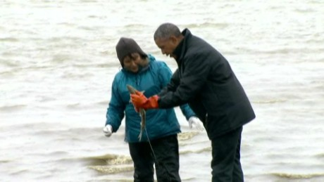 Salmon spawns on Obama while fishing in Alaska