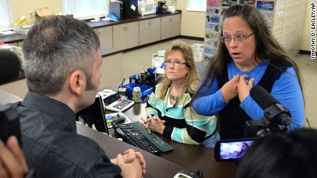 Rowan County Clerk Kim Davis, right, talks with David Moore following her office's refusal to issue marriage licenses at the Rowan County Courthouse in Morehead, Ky., Tuesday, Sept. 1, 2015. Although her appeal to the U.S. Supreme Court was denied, Davis still refuses to issue marriage licenses.