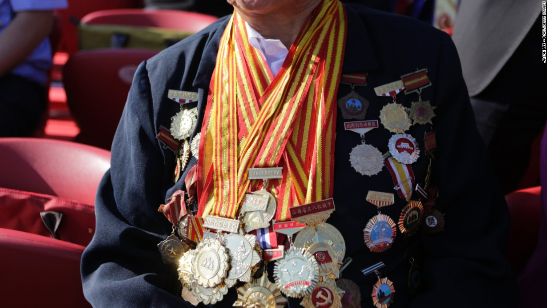 Decorated with medals, 85-year-old Shen Ji-lan prepares for the military parade in Beijing. She is the only person in China to be appointed twelve consecutive times as a member of the National People's Congress, China's legislature, according to local media.