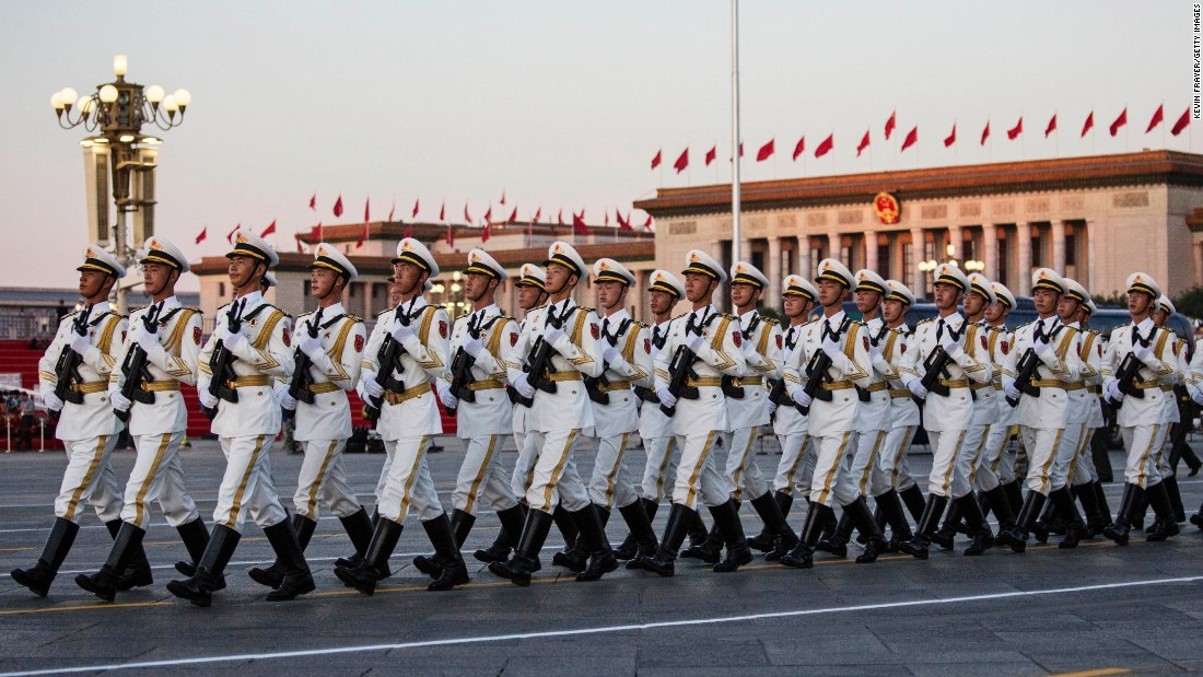 Chinese soldiers march past the Great Hall of the People in Tiananmen Square on September 3 in Beijing, China.