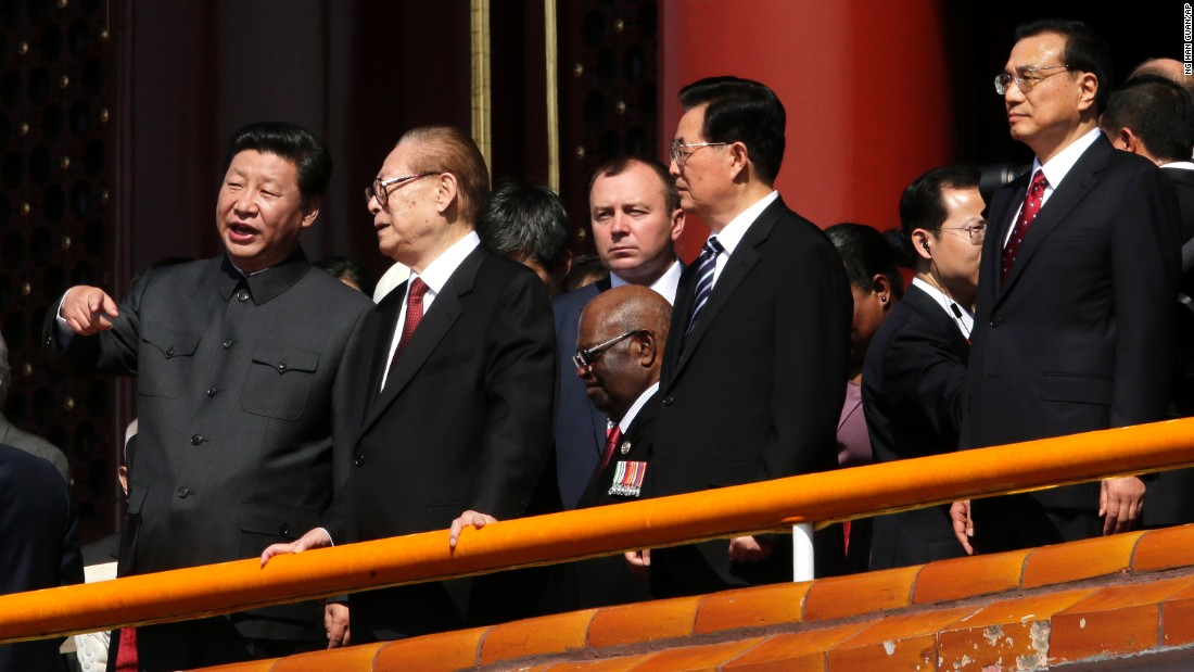Chinese President Xi Jinping, left, stands with former Chinese Presidents Jiang Zemin and Hu Jintao and current Premier Li Keqiang at the military parade in Beijing on September 3.