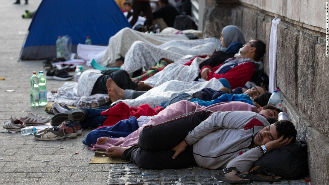 Refugees and migrants sleep outside the station. On Thursday, Hungarian Prime Minister Viktor Orban is meeting with other members of the European Union to figure out how to cope with the emergency.
