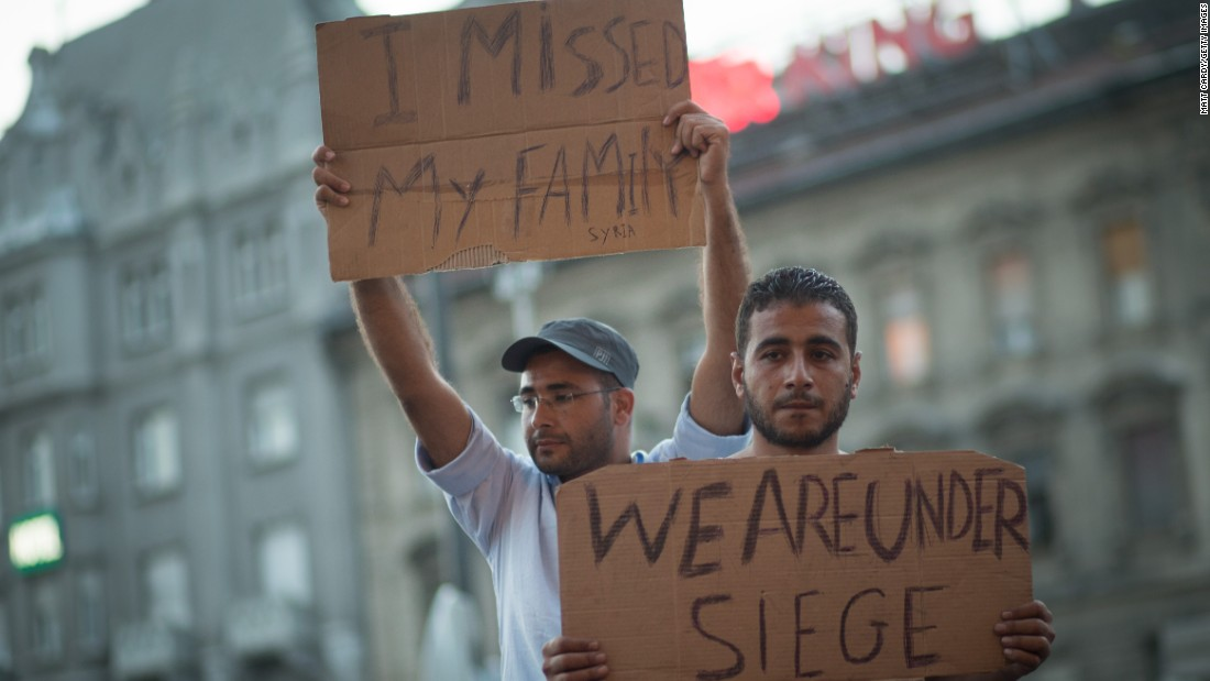 Refugees and migrants protest outside Keleti station.