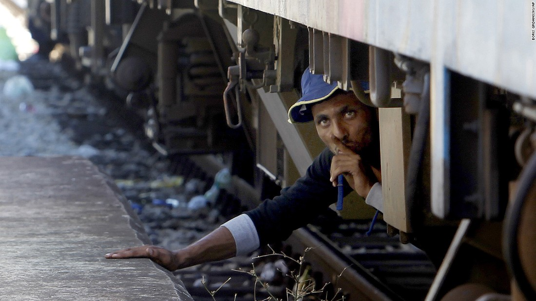 A migrant in Gevgelija, Macedonia, tries to sneak onto a train bound for Serbia in August 2015.