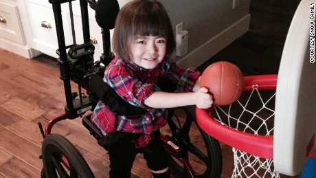 Julianna turned circles in her wheelchair before her hands became too weak to work the controls.