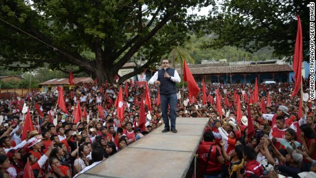 Guatemalan presidential candidate for the Renewed Democratic Liberty party (LIDER), Manuel Baldizon (C), speaks to supporters during a campaign rally, at Sacapulas municipality, Quiche department, 212 km northwest of Guatemala City on August 25, 2015. General elections will take place next September 6 in Guatemala