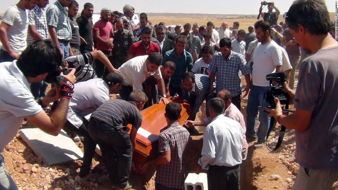 One of the coffins gets lowered into the ground September 4, 2015, in Kobani.