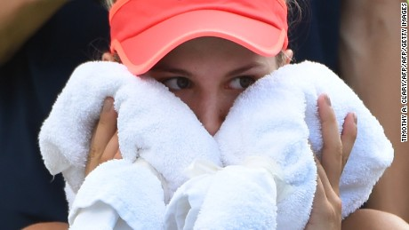 Eugenie Bouchard holds a towel to her face at the U.S. Open women's singles match on September 4, 2015 in New York.