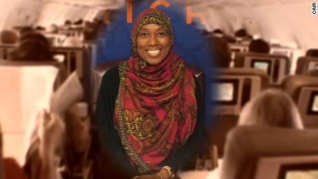 Muslim flight attendant says she was suspended by ExpressJet for refusing to serve alcohol in accordance with her Islamic faith.