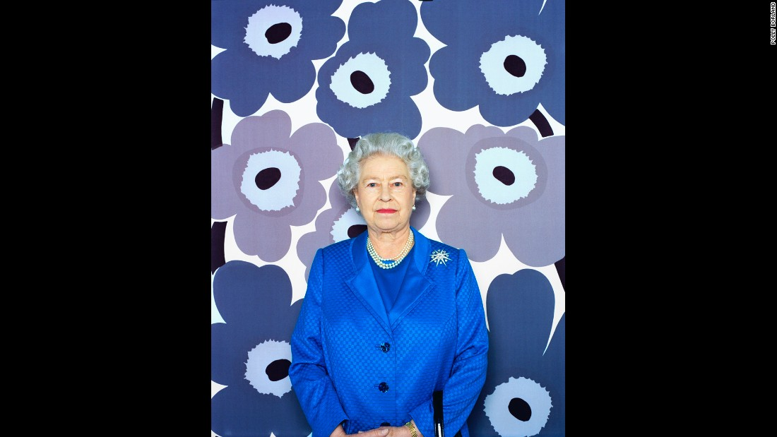 "When she saw the blue flower print, the Queen ""went 'Oooohhh!' and was very shocked,"" Borland recalled."