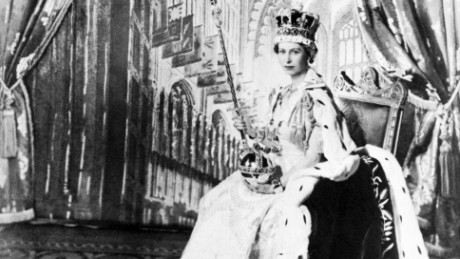 Queen Elizabeth II poses with the royal sceptre 02 June 1953 after being crowned solemnly at Westminter Abbey in London. Elizabeth was proclaimed Queen in 1952 at age 25.        (Photo credit should read STF/AFP/Getty Images)