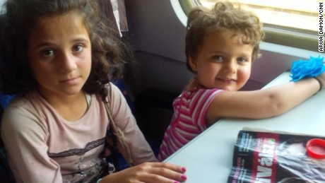 Rym, 8, and Birlnt, 2 1/2, on the train as it starts to move.