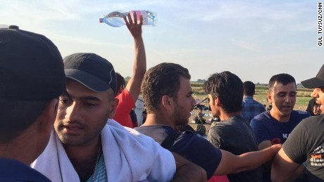 One journalist went to a store and bought water to give to the refugees.