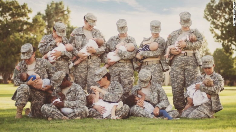 Soldiers pose for photo breastfeeding their children