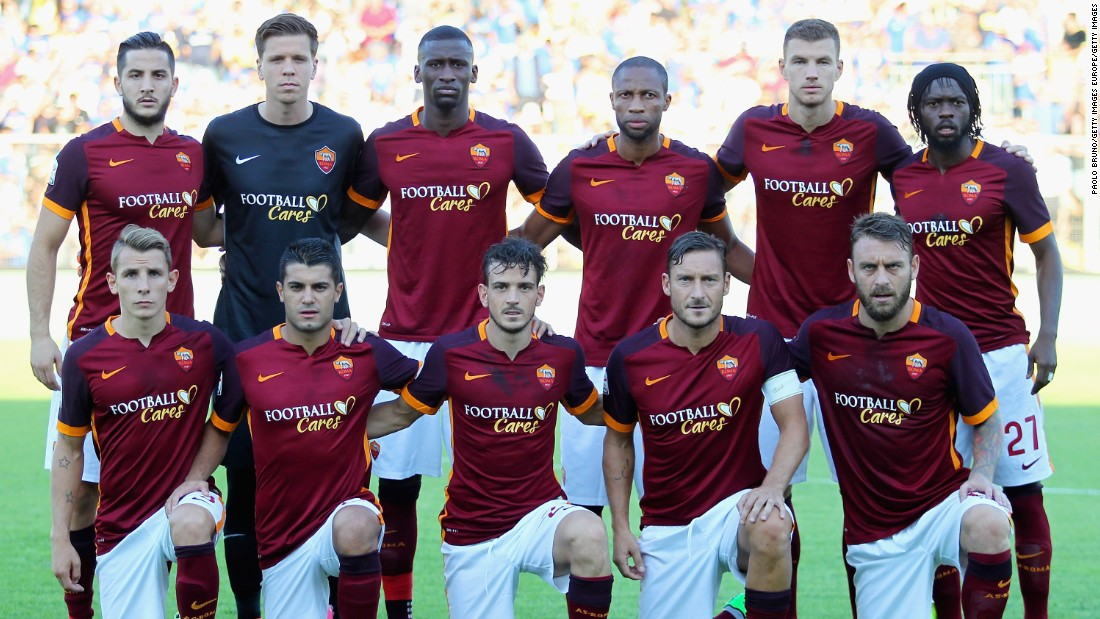 "Roma players pose for a team picture before a Serie A match against Frosinone with ""Football Cares"" emblazoned across their jerseys."