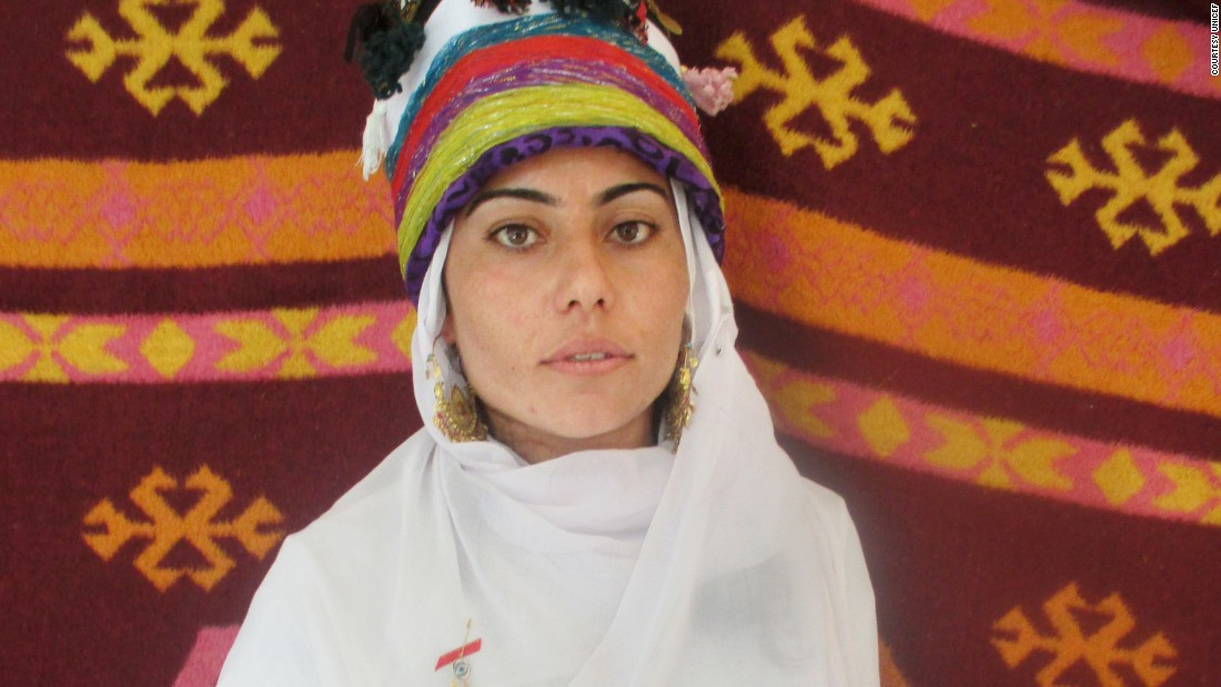 18-year-old Barfi's photography project focused on traditional Yazidi dress. She took portraits of friends and relatives against colorful backdrops in her camp. This is her sister wearing celebratory clothing.