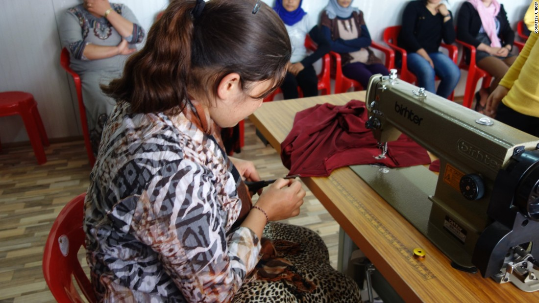 "19-year-old Zina took this picture during a dress making course. ""It's a favorite picture because this woman [was] working as a tailor ... she doesn't give up."""