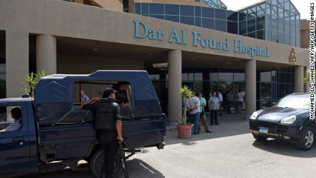 "Egyptian security members stand guard as newly appointed Tourism Minister Khaled Ramy arrives at the Dar al-Fouad Hospital in a western Cairo suburb to visit injured tourists who were mistakenly targeted by a joint police and military operation ""chasing terrorist elements"", on September 14, 2015. Egyptian security forces have mistakenly killed 12 people including Mexican tourists while chasing jihadists in the country's vast Western Desert, drawing condemnation and calls for an investigation from Mexico. AFP PHOTO / MOHAMED EL-SHAHED        (Photo credit should read MOHAMED EL-SHAHED/AFP/Getty Images)"