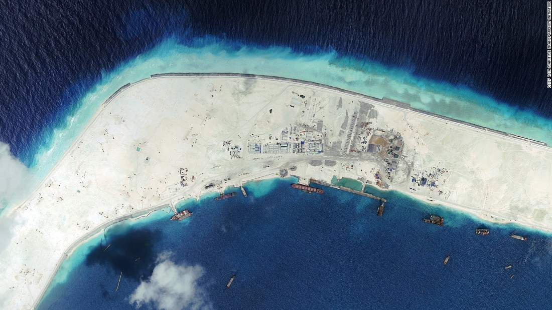 This satellite image taken on September 8, 2015 shows Mischief Reef in the South China Sea. China reclaimed a flat rectangle of land with a retaining wall about 3,000 meters  (3,280 yards) in length, pictured in the top left.