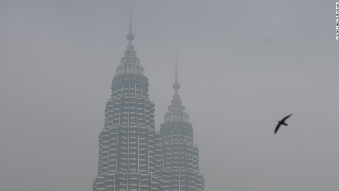 Malaysia's iconic Petronas Twin Towers are seen cloaked in haze in Kuala Lumpur on September 15.
