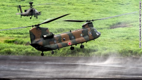 Japan's new military policy making region wary