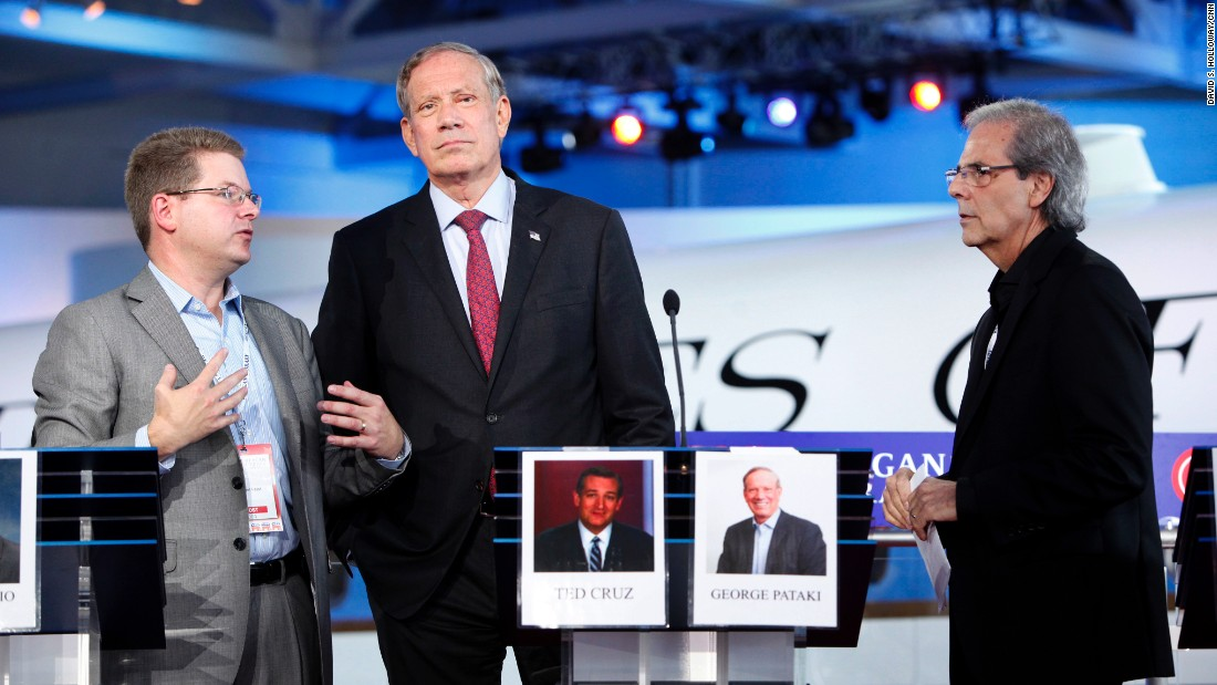 Pataki stands on stage during preparations for the debate.