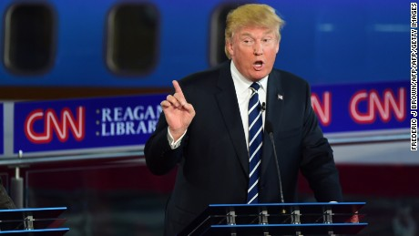 Republican presidential hopeful Donald Trump gestures during the Republican Presidential Debate at the Ronald Reagan Presidential Library in Simi Valley, California, September 16, 2015.