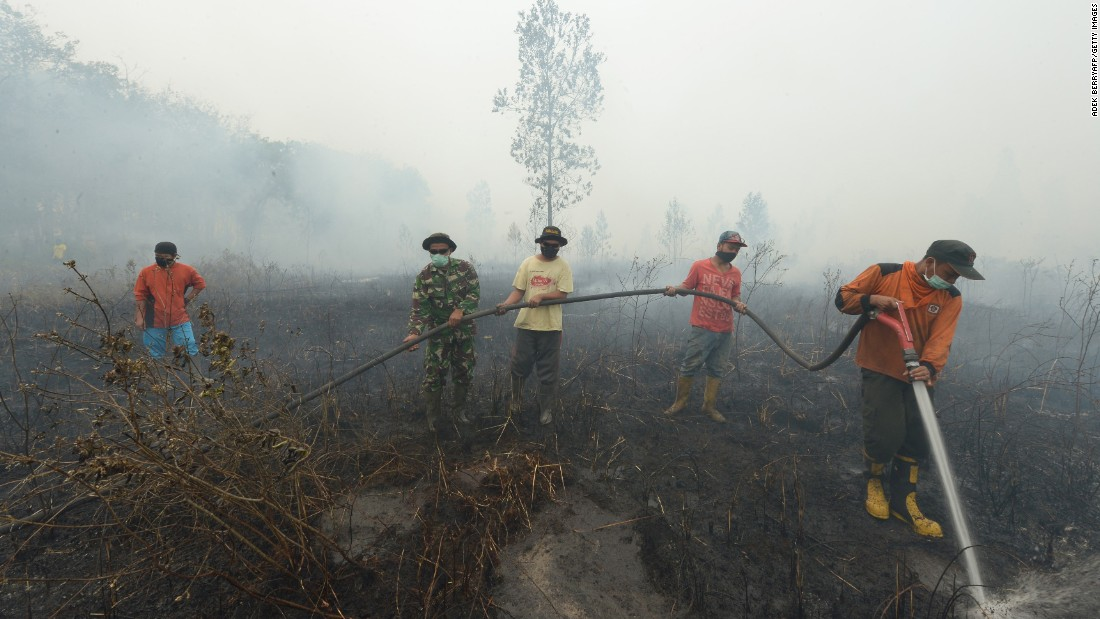 Firefighters work in Kampar on Sunday, September 13.