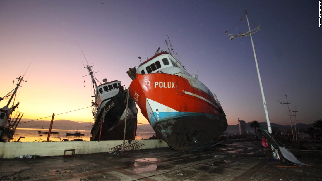A boat stands on a dock after it was lifted by tsunami waves in Coquimbo, Chile, on September 17.