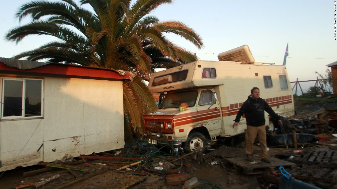 A man stands in front of a damaged RV in Concon on September 17.