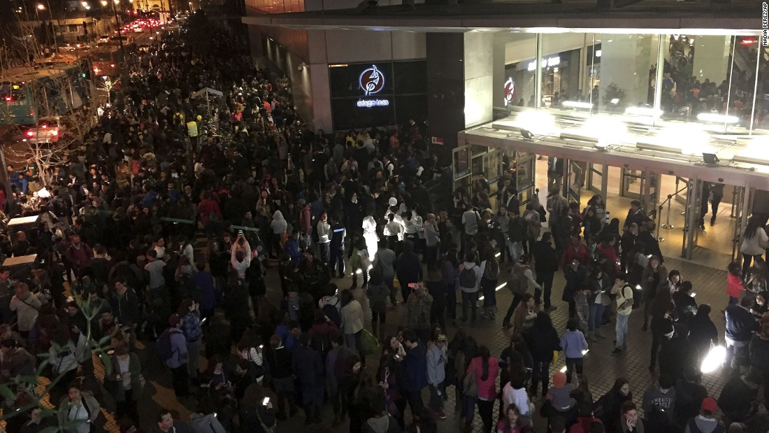 People evacuate a mall in Santiago, Chile, on September 16.