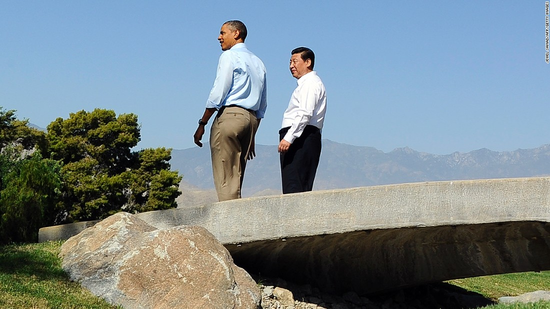 Both forgoing neckties, Barack Obama and Xi Jinping take a late-morning stroll at the Annenberg Retreat at Sunnylands, a private estate in California known for hosting Frank Sinatra and Ronald Reagan, on June 8, 2013. The summit, held just four months after Xi took office, was meant to forge a close relationship with the new Chinese leader.