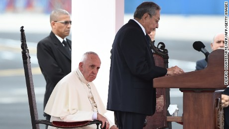 Pope Francis (L) listens to Cuban President Raul Castro delivering a speech during the welcoming ceremony at Havana's international airport on September 19, 2015 on the first leg of a high-profile trip that will also take him to the United States. The Alitalia plane carrying Pope Francis touched down at Havana's Jose Marti airport at 3:50 pm (1950 GMT), as thousands of people lined the road into the city, which was decked out in giant posters of the Argentine pontiff.  AFP PHOTO / FILIPPO MONTEFORTE        (Photo credit should read FILIPPO MONTEFORTE/AFP/Getty Images)