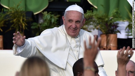 Pope Francis arrives at Revolution Square in Havana on September 20, 2015. Pope Francis will give mass on Revolution Square, the biggest event of his trip to Cuba, with nearly a million people expected to attend. The pontiff's eight-day tour will also take him to the United States.   AFP PHOTO / RODRIGO ARANGUA        (Photo credit should read RODRIGO ARANGUA/AFP/Getty Images)